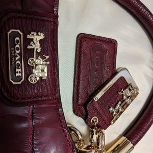 Raspberry Coach Handbag.